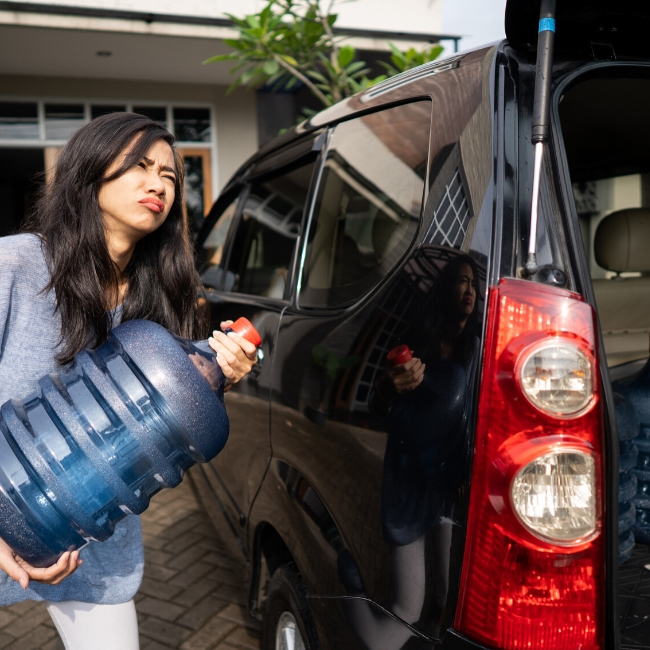 woman carrying 5 gallon water