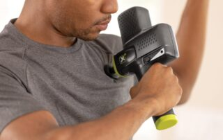 using a percussion massager on trigger points